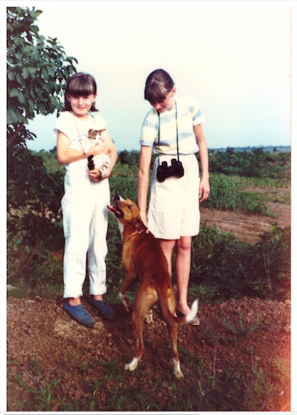 My sister and I, on the left, in Nigeria, around 1984. I used to be the happiest kid.
