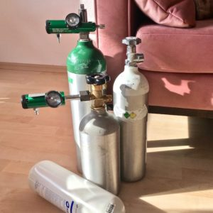 a collection of oxygen tanks for home ozone therapy