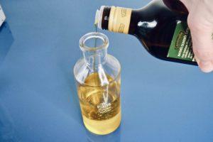 10 pour oil into oil bubbler copy 2