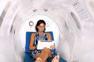 woman in an hyperbaric oxygen chamber