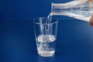 9 pour the water into a glass